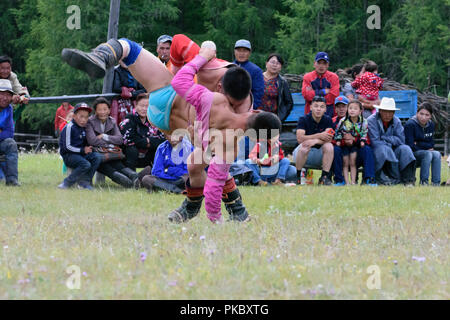 Mongolian wrestling competition near the Khovsgol Lake, Mongolia - Stock Image