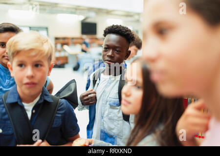 Junior high students in library - Stock Image