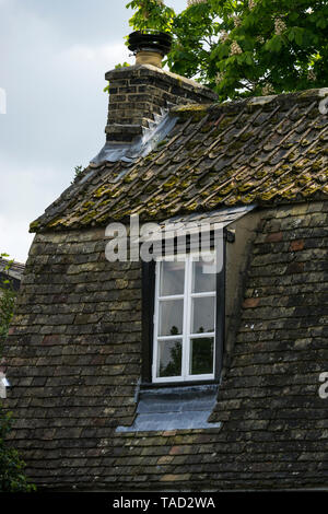 Window in Dutch style roof - Stock Image
