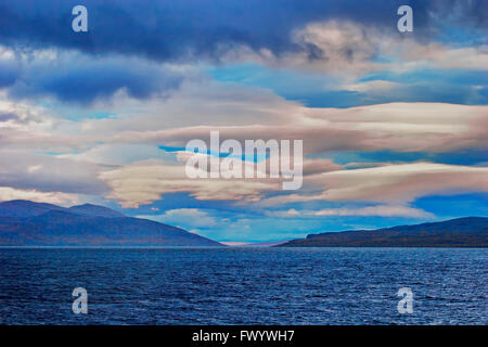 Cloudy sky over lake Torneträsk in Swedish Lapland at dusk. - Stock Image