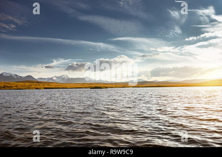Beautiful mountains landscape with big lake and snowcapped mountains on background. Altay region, Siberia, Russia - Stock Image