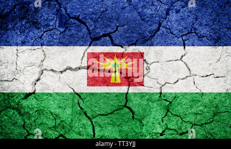 Barinas State flag, state of Venezuela, on dry earth ground texture background - Stock Image