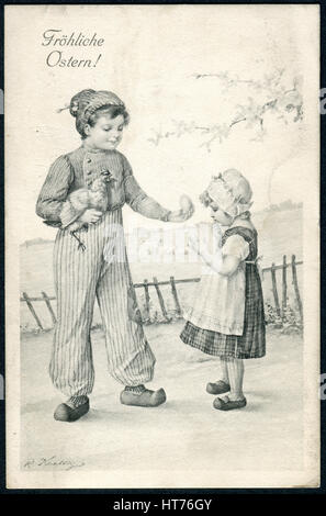 A postcard printed in Austria, shows a boy with a chicken egg on hands gives the girl. The inscription in German: - Stock Image
