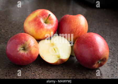 Eating apples ready to eat. Variety Jazz - Stock Image