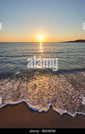 Wave hem at sunset, Agia, Thessaly, Crete, Greece - Stock Image