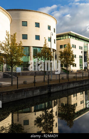 Civic Centre reflected in canal  at Lagan Valley Island, Lisburn, County Antrim, N.Ireland. (vertical) - Stock Image