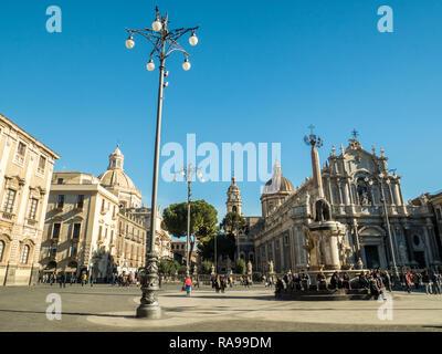 PIazza del Duomo with the Cathedral of Saint Agatha (Sant'Agata) right & the Church of the Badia di Sant'Agata left & the Elephant fountain, Catania, - Stock Image