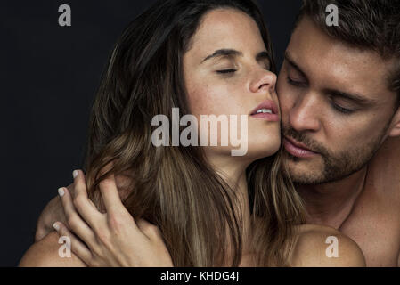 Passionate couple cheek to cheek with eyes closed - Stock Image