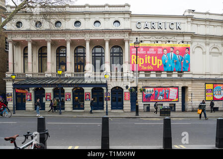 The Garrick Theatre in Charing Cross Road, London, England, UK. A large colourful poster advertises the musical show Rip it Up. - Stock Image