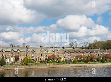 Terrace of houses, and Wharfemeadows Park, by the River Wharfe, Otley, West Yorkshire, England UK - Stock Image