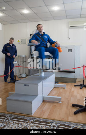 International Space Station Expedition 59 backup crew member Drew Morgan rides the rotating chair testing his vestibular system at the Baikonur Cosmodrome March 7, 2019 in Baikonur, Kazakhstan. Expedition 59 crew: Christina Koch of NASA, Alexey Ovchinin of Roscosmos, and Nick Hague of NASA will launch March 14th onboard the Soyuz MS-12 spacecraft for a six-and-a-half month mission on the International Space Station. - Stock Image