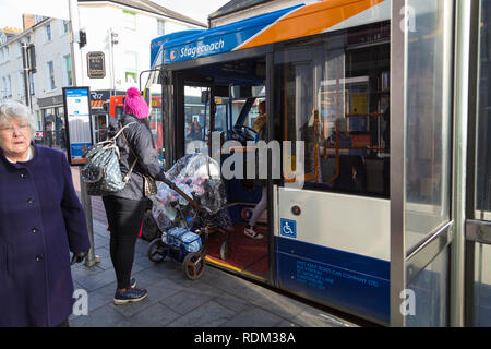A woman getting on a stagecoach bus with stroller, ashford town centre, kent, uk - Stock Image