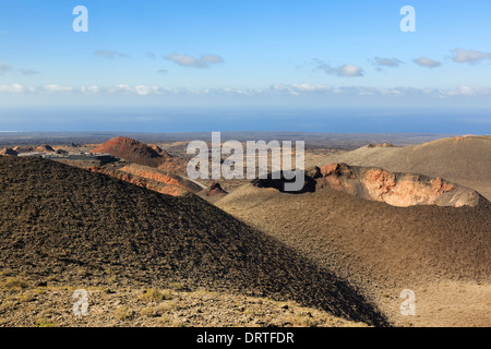 Montanas del Fuego or Fire Mountains and volcanic landscape of lava ash and a crater in Parque Nacional de Timanfaya National Park, Lanzarote - Stock Image
