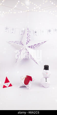 Christmas Decoration with star gift  box and snow man with christmas star and garland snow for holidays best background - Stock Image