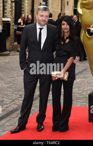 LONDON, UK. April 28, 2019: Charlie Brooker & Konnie Huq at the BAFTA Craft Awards 2019, The Brewery, London. Picture: Steve Vas/Featureflash - Stock Image