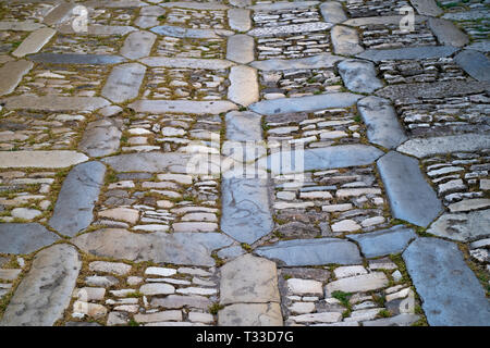 Patterns on the ground in pastel colours in cobble stones alleyway in Erice, Sicily, Italy - Stock Image