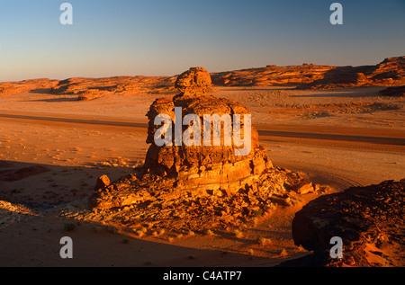 Saudi Arabia, Madinah, nr. Al-Ula. Rocky stacks and bluffs dot the stark landscapes on the edge of the Nefud (aka - Stock Image