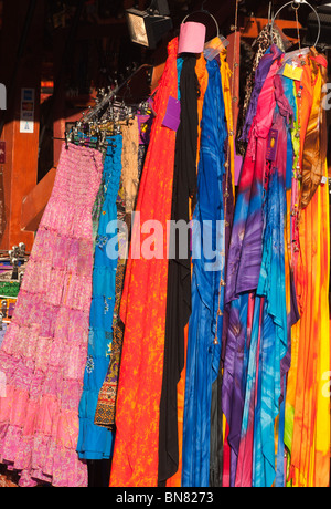 Shawls and dresses on sale at a stall at the Tollwood festival in Munich - Stock Image