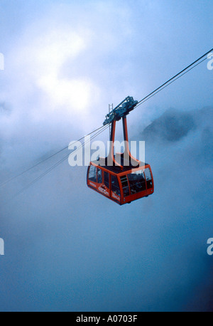 The Last Stage of the Merida Cable Car to Pico Espejo as it Passes through the Cloud Covered Peaks of the Andes Venezuela - Stock Image