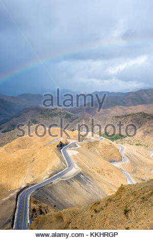 Morocco, Marrakech-Safi (Marrakesh-Tensift-El Haouz), Al Haouz Province. Rainbow over the Tizi N'Tichka pass - Stock Image