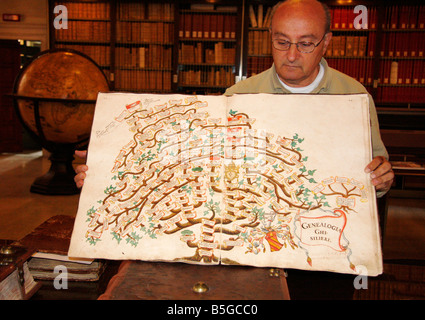 librarian of the famous historic library in Jesi,Le Marche,Italy,shows the family tree of an ancient ruling family - Stock Image