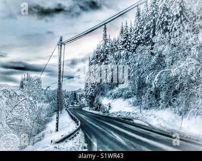 Snow covered road - Stock Image