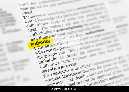 Highlighted English word 'authority' and its definition at the dictionary. - Stock Image