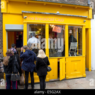 Queue of people outside The Breakfast Club, Camden Passage, Islington London England UK - Stock Image