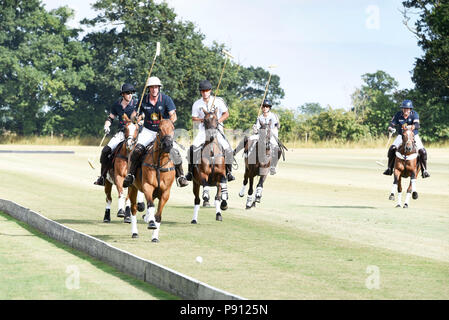 Prince William, the Duke of Cambridge, playing a charity polo match in Norfolk England - Stock Image