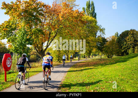 Cyclists taking advantage of a sunny Autumn day beside the River Ouse in York, Yorkshire, UK - Stock Image