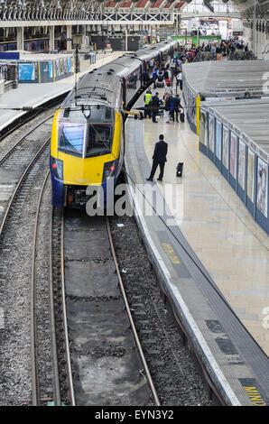 A platform with waiting train at Paddington Station, London, England, UK - Stock Image