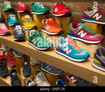 New Balance Trainers on display in a shop - Stock Image
