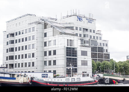 The Northern Shell office in Crossharbour overlooks the dock. - Stock Image