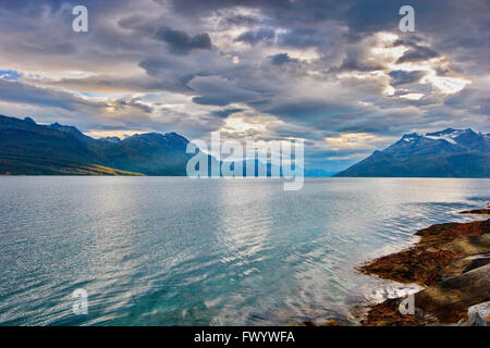 Clouds are towering over Salangen-Fjord and island  Andørja in northern Norway. - Stock Image