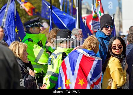 London, England, UK. Metropolitan police officers policing Brexit protests in Westminster, April 2019 - Stock Image