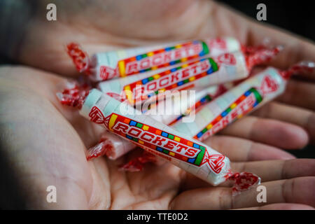 a handful of rockets candy which are canadian version of smarties - Stock Image