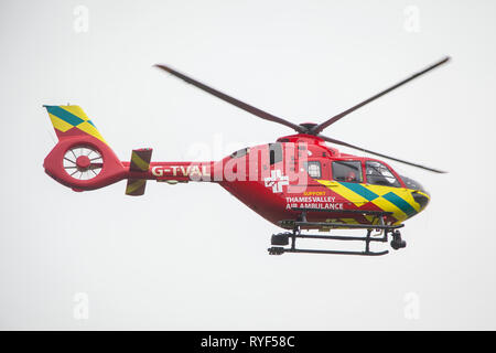 The Thames Valley Air Ambulance helicopter in flight. - Stock Image