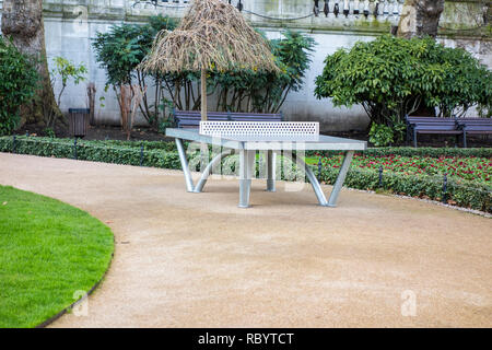 Outdoor ping pong table at Victoria Embankment Gardens, London, UK - Stock Image