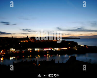 Whitby harbour at night Esk Valley North Yorkshire Moors England United Kingdom UK Great Britain GB Steam & - Stock Image