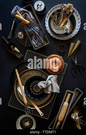Baking and patisserie equipment over black background - Stock Image