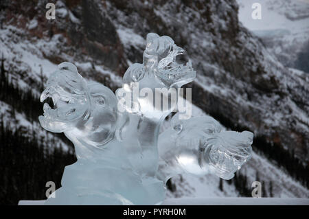 Cerebus Ice Carving at the Ice Magic Festival at the Chateau Lake Louise in Banff National Park, Alberta, Canada. - Stock Image