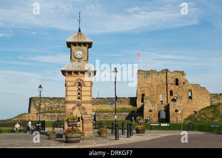Victorian clocktower and Tynemouth Priory, England - Stock Image