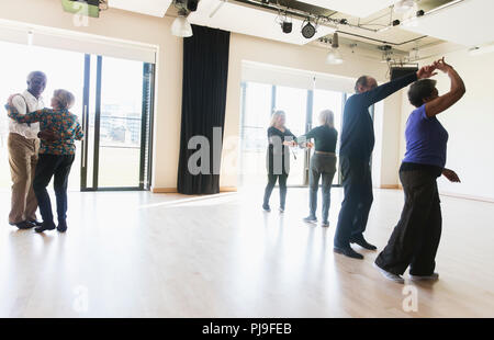 Active seniors dancing in dance class - Stock Image