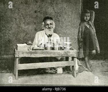 Jewish sweetmeat seller, Lahej (Abdali, Al Houta) Bazaar, Gulf of Aden, Arabia (then part of the British Empire). - Stock Image