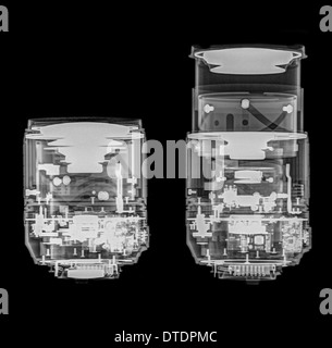 Camera lens under x-ray. the optical elements can be seen. Nikkor 18-105mm zoomed to 18mm (left) and 105mm (right) - Stock Image