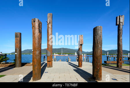View of Totems, public art on Marlin Wharf depicting past Aboriginal life in the area, Cairns, Far North Queensland, FNQ, QLD, Australia - Stock Image