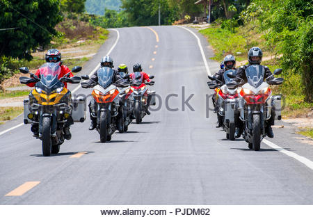 Group of biker friends on adventure motorcycle ride, Nan, Thailand - Stock Image