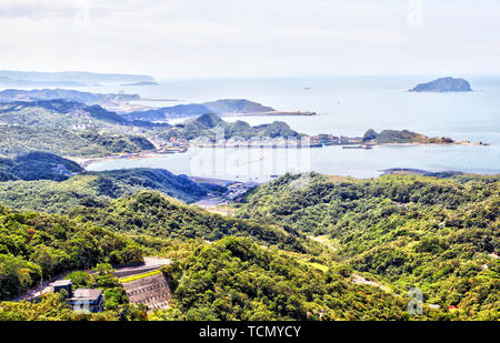 Keelung Mountain near Taipei with a view toward the Keelung Islet on South China Sea with hillside village of Jiufen in the foreground. At 588 meters  - Stock Image
