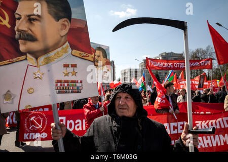 A man takes part in a march held by the Russian Communist Party (KPRF) to mark International Workers' Day on Moscow streets, Russia - Stock Image