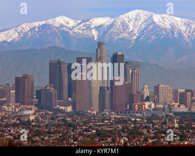Skyline of downtown Los Angeles California with the snow capped San Gabriel Mountains. - Stock Image